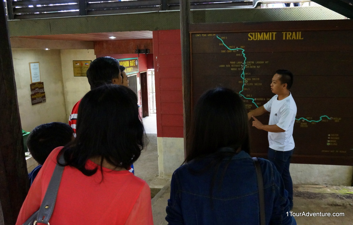 Tour guide Nazri explaining his experience scaling Mt. Kinabalu many years ago